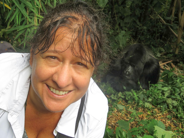 Lisa with a silver back gorilla in Rwanda
